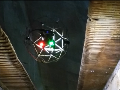This a feature image of a drone flight up into a tall boiler.