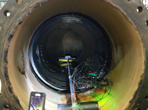 This is an image of a drone inspecting a pipe